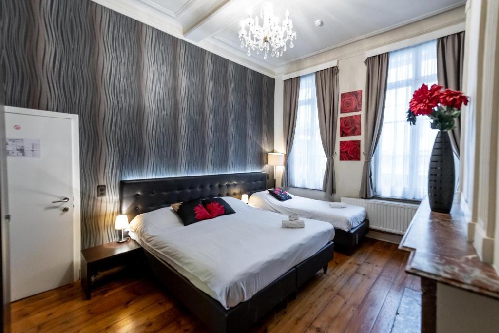 Een bed of bedden in een kamer bij Hotel Onderbergen