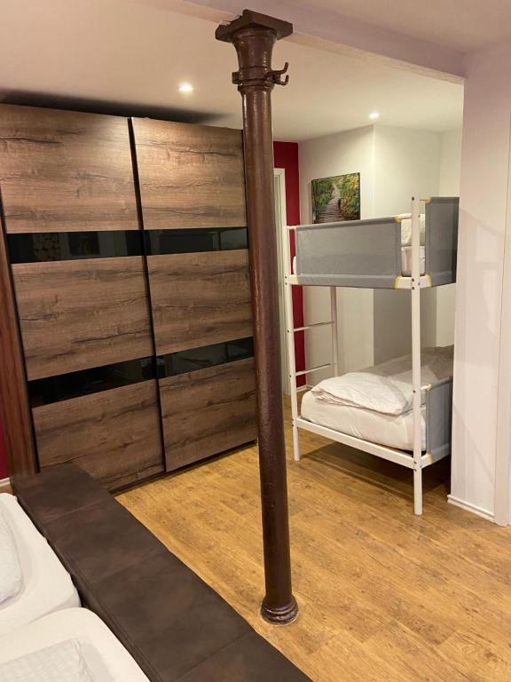 A bunk bed or bunk beds in a room at Landgasthaus Alter Posthof