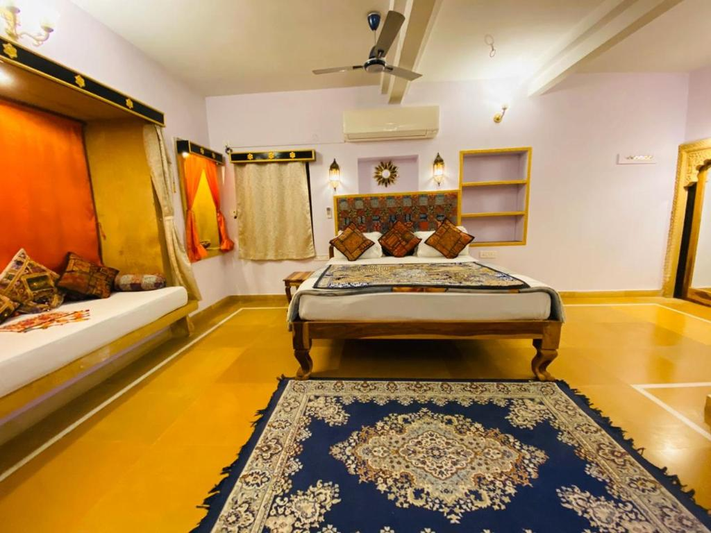 A bed or beds in a room at Shanti Home