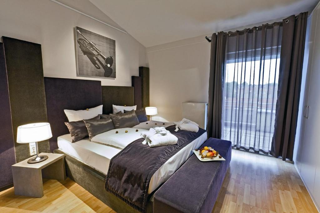 A bed or beds in a room at Art Hotel Superior