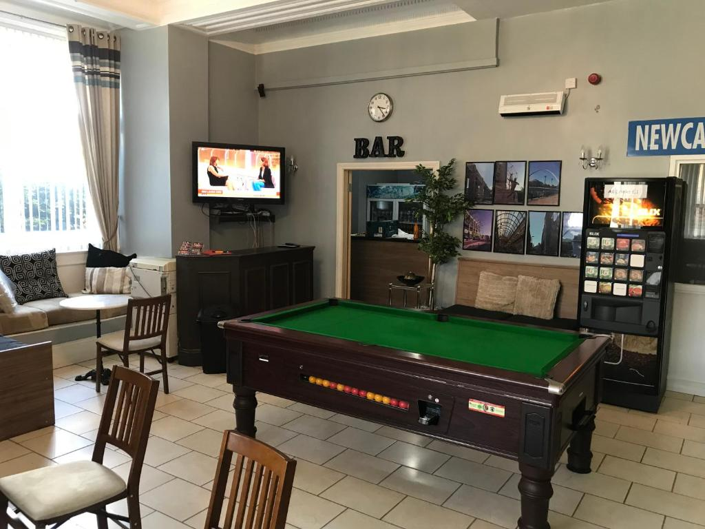 A pool table at Newcastle West Hotel & Bar