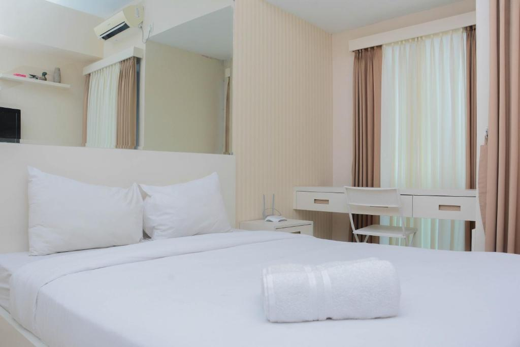 A bed or beds in a room at Clean Studio Apartment at Grand Dhika City By Travelio