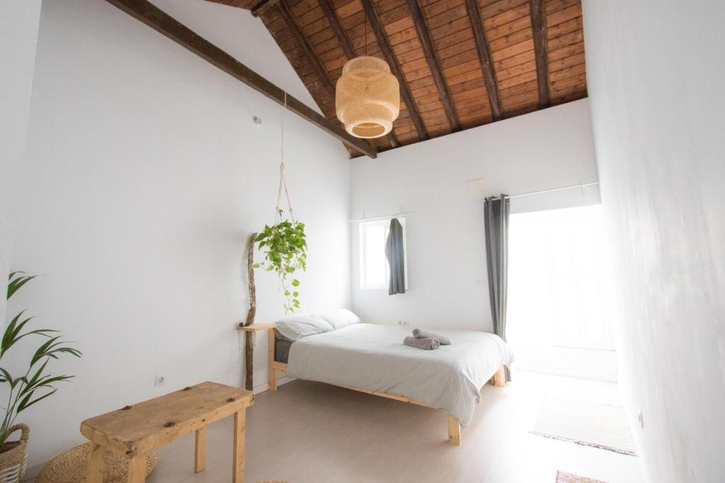 A bed or beds in a room at Casa Calma Yoga Guesthouse