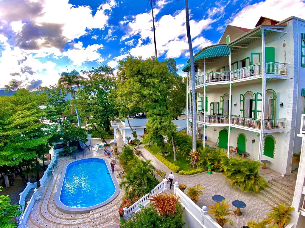 A view of the pool at Manoir Adriana Hotel or nearby