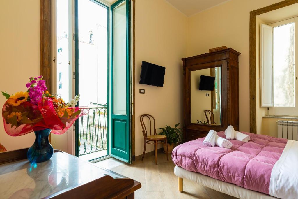 A bed or beds in a room at La Casa di Nonna Lella