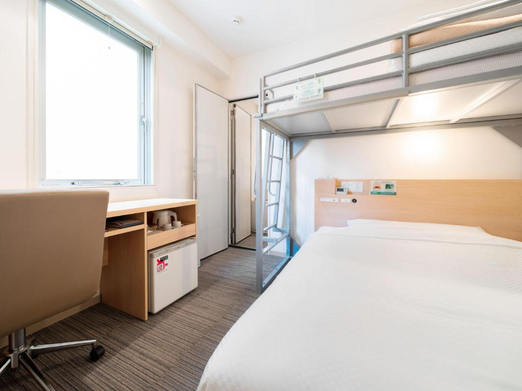 A bed or beds in a room at Super Hotel Asakusa