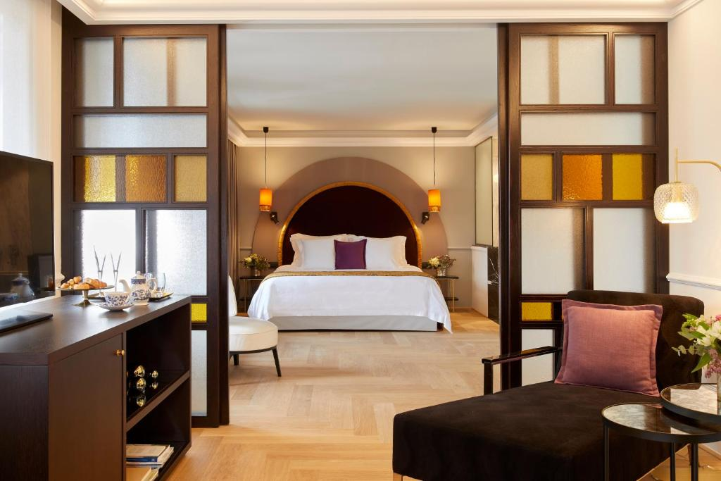 A bed or beds in a room at The Excelsior
