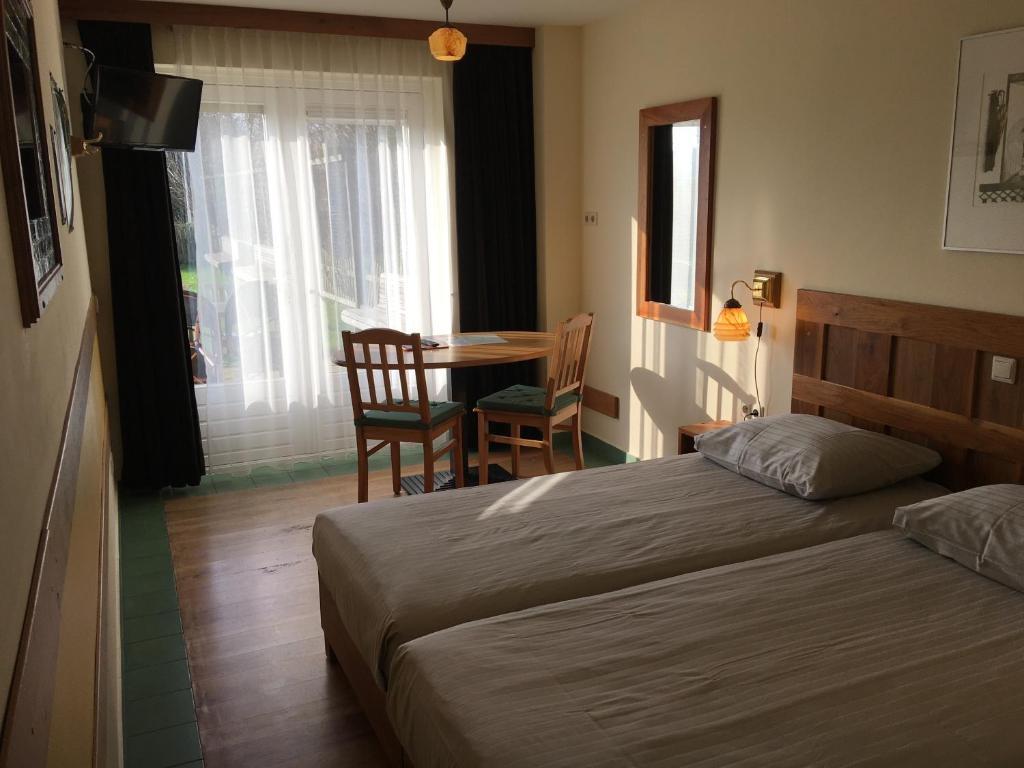 Un ou plusieurs lits dans un hébergement de l'établissement Carels Kamers Texel