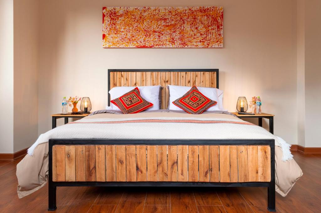 A bed or beds in a room at The Nest La Paz