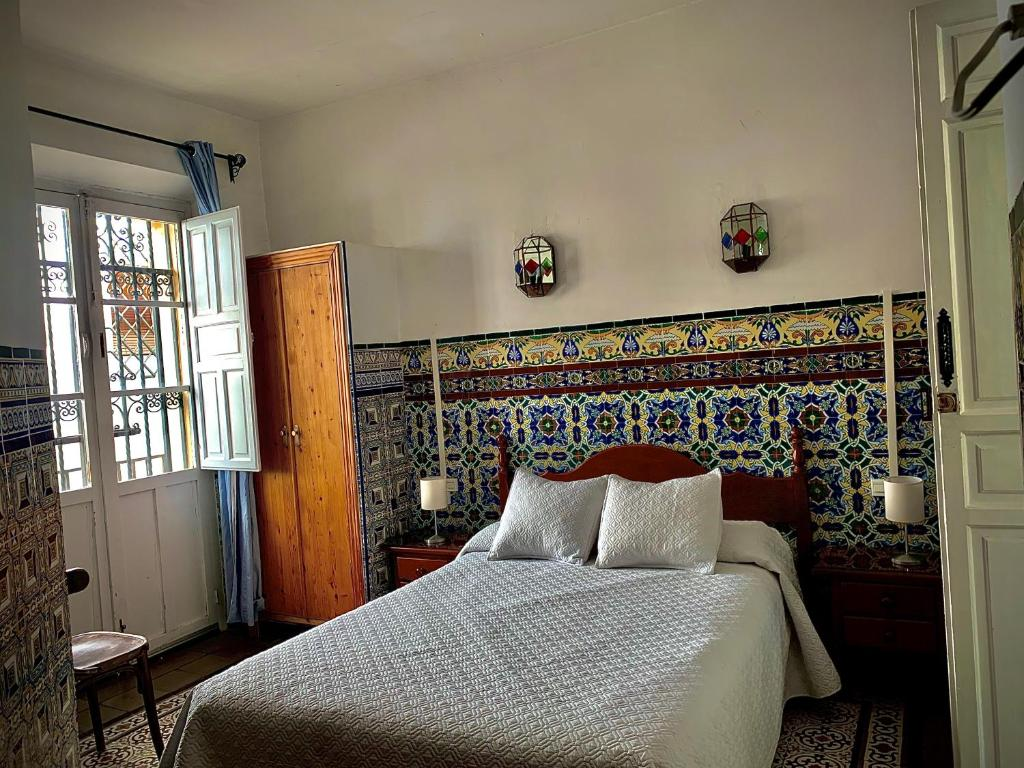 A bed or beds in a room at Hostal Lis