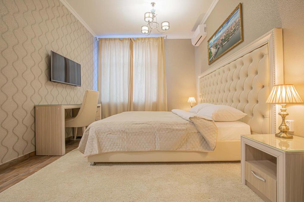"""Кровать или кровати в номере Мини-отель """"В Ростове Жить"""""""