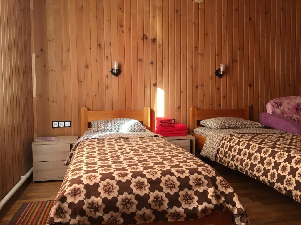 Кровать или кровати в номере Гостевой дом S N e G