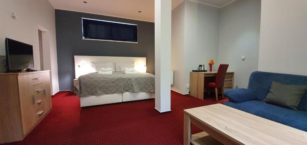 Кровать или кровати в номере Saraya Wellness & Penzion