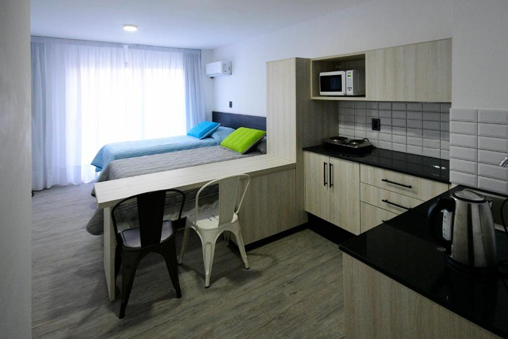 A kitchen or kitchenette at Quijano Aparts&Suites