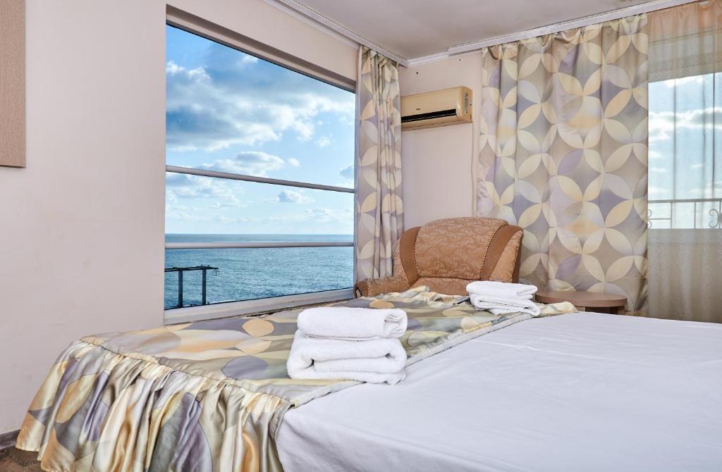 Кровать или кровати в номере Мечта Отель