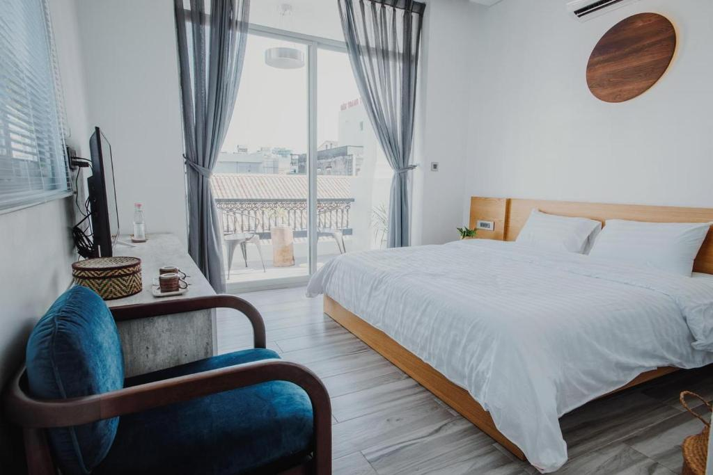 A bed or beds in a room at Vien Hotel