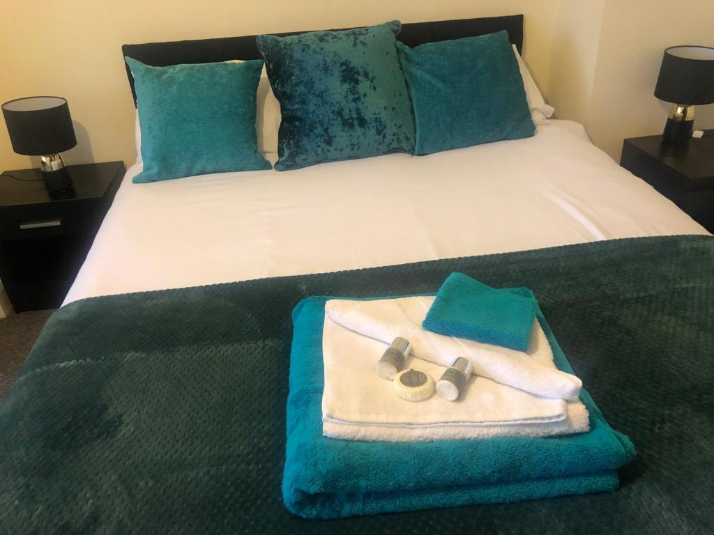 A bed or beds in a room at The Upper Room Apartment