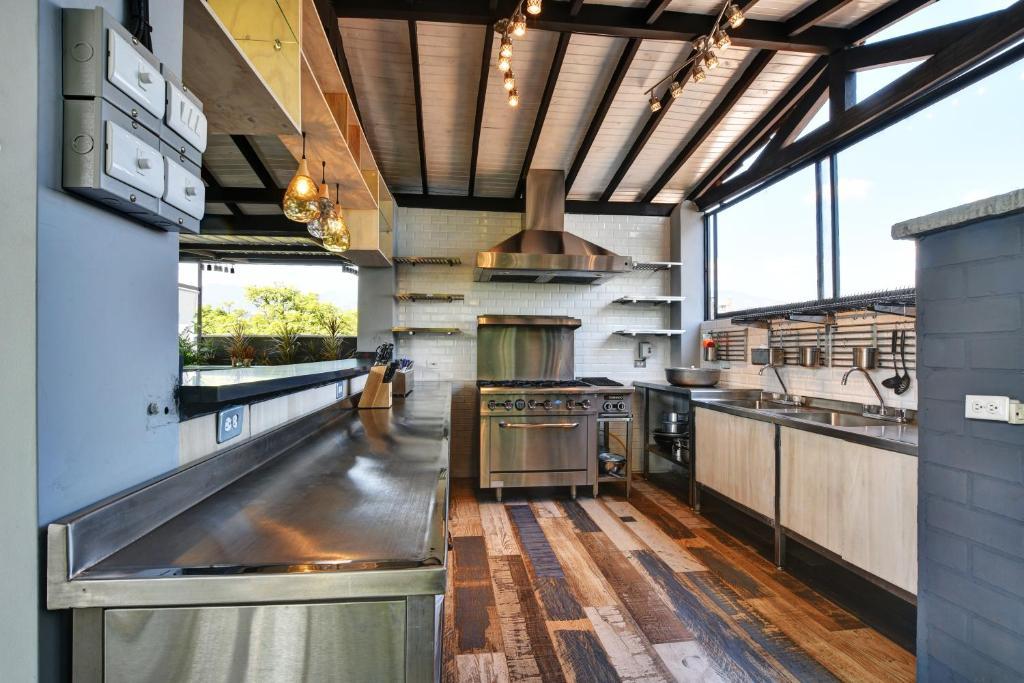 A kitchen or kitchenette at International House Co-Living Hostel Medellin