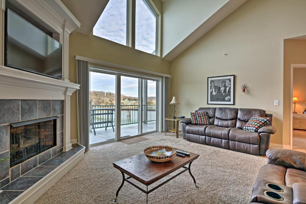 A seating area at Waterfront Condo on Lake of the Ozarks with 2 Pools!