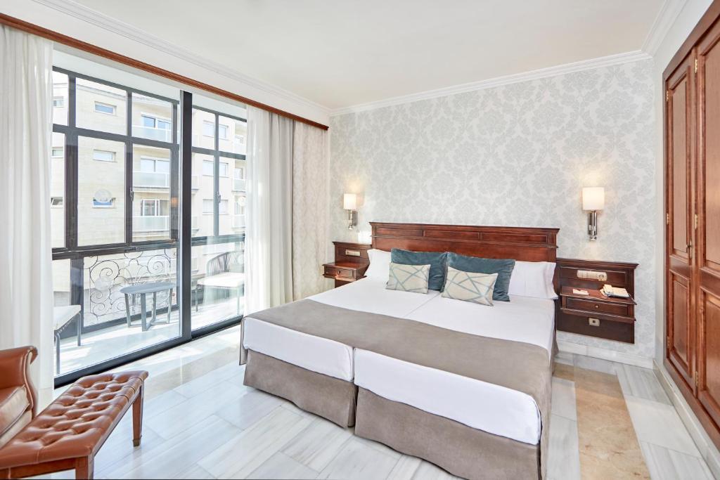 Cama o camas de una habitación en Hotel Continental Palma