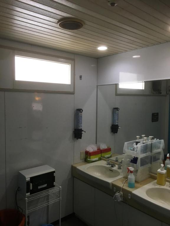 A kitchen or kitchenette at Capsule Inn Sapporo (Male Only)