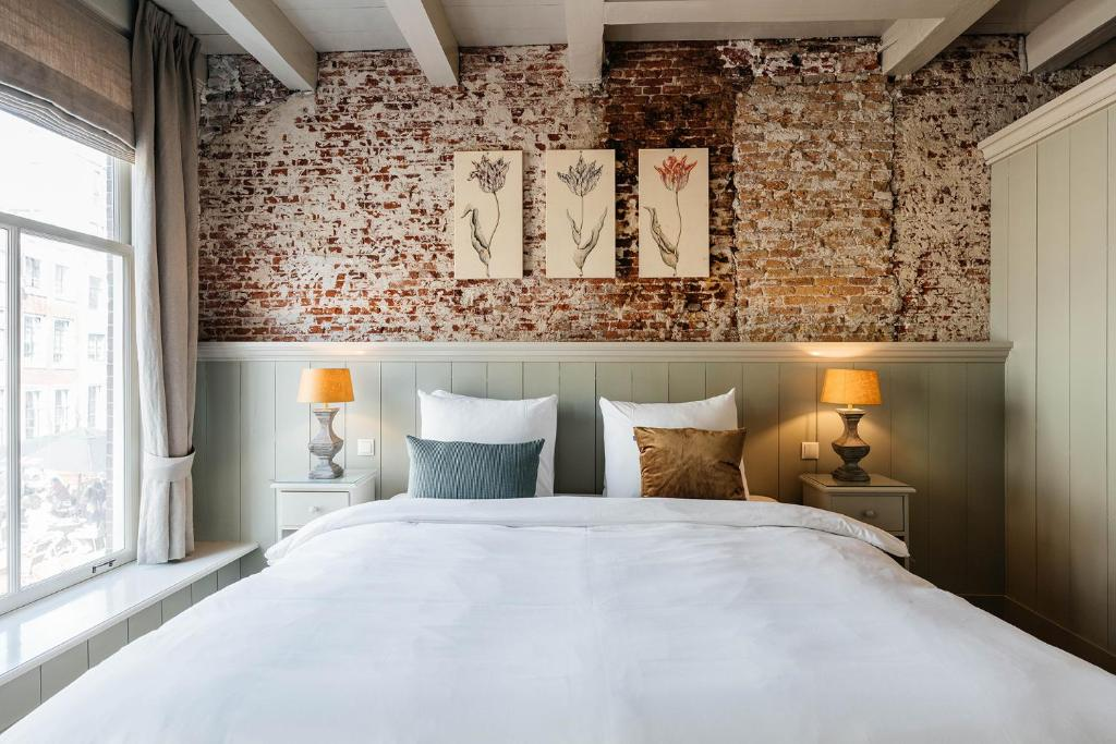A bed or beds in a room at Logement Petit Beijers