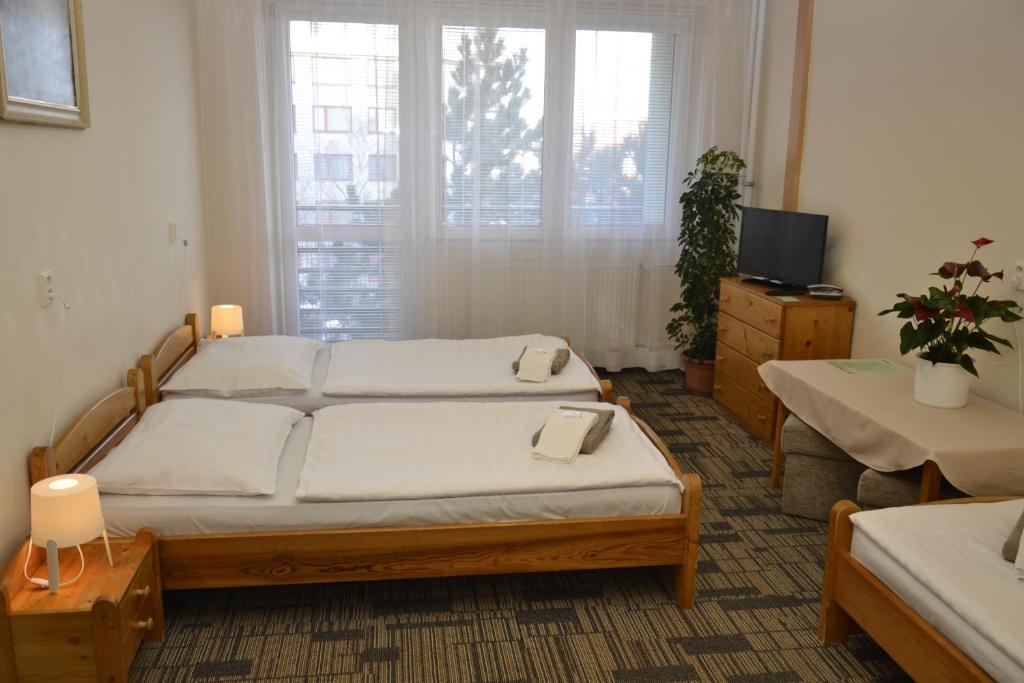 Кровать или кровати в номере Volha