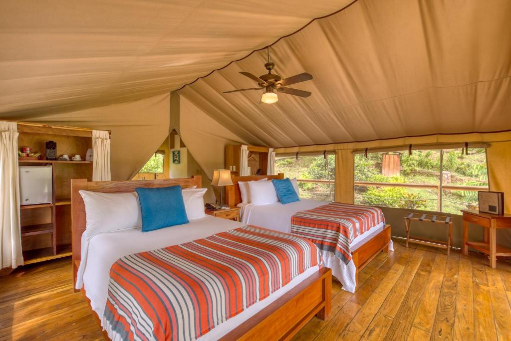 A bed or beds in a room at Isla Chiquita Glamping Hotel