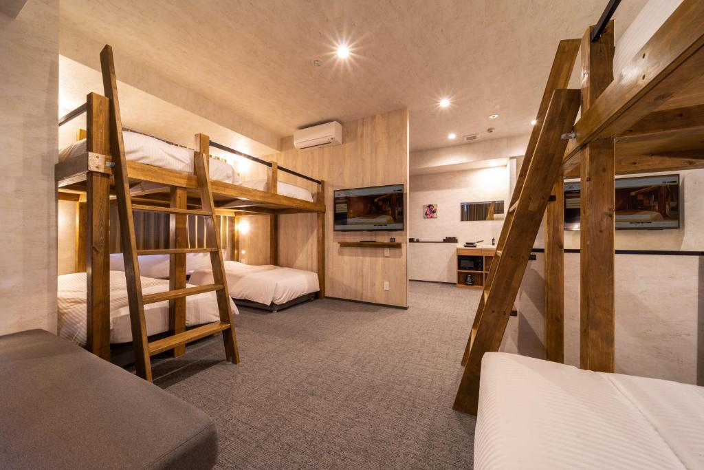 A bunk bed or bunk beds in a room at WELLSTAY Namba