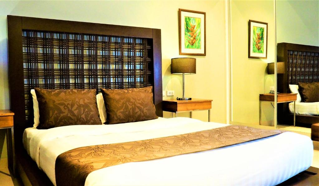 A bed or beds in a room at Aloha Boracay Hotel