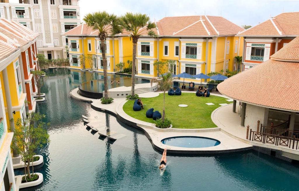 A view of the pool at The Royal Family Suites or nearby