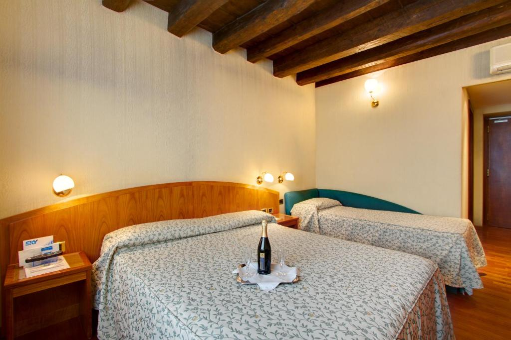 A bed or beds in a room at Hotel Corot