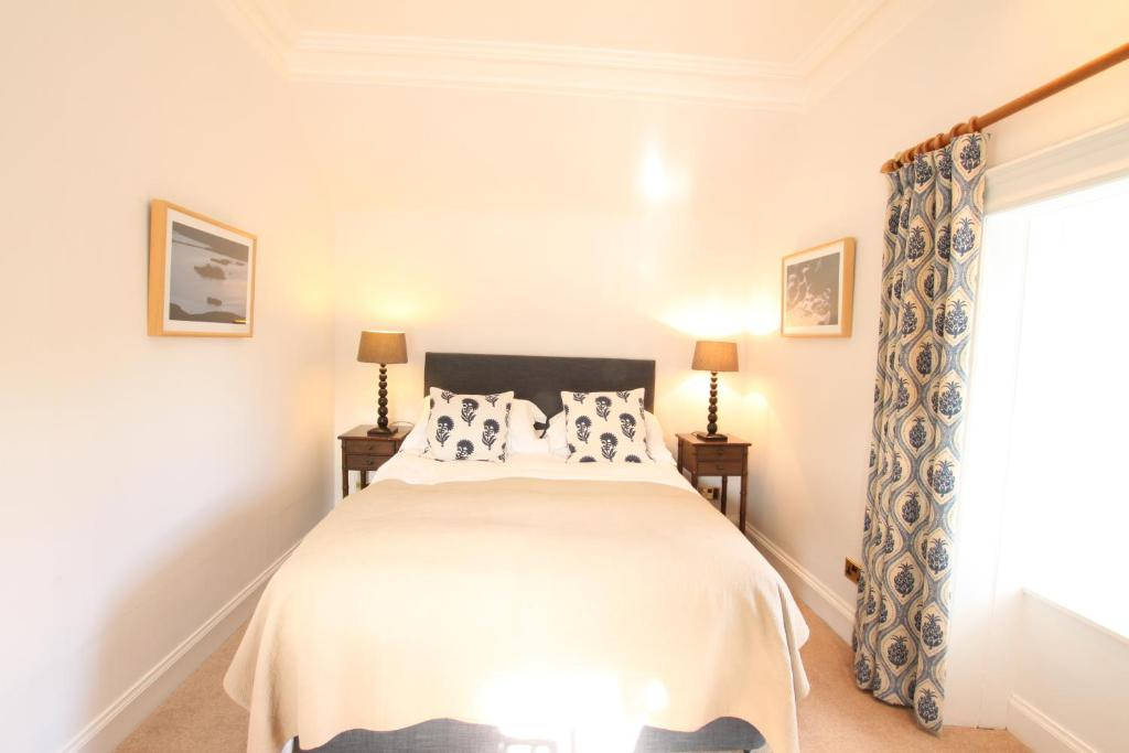 A bed or beds in a room at The Colonsay Hotel