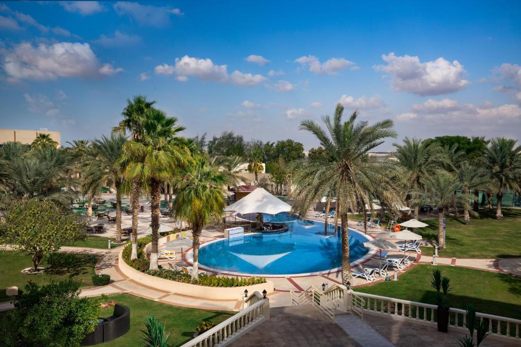 A view of the pool at Millennium Central Al Mafraq or nearby