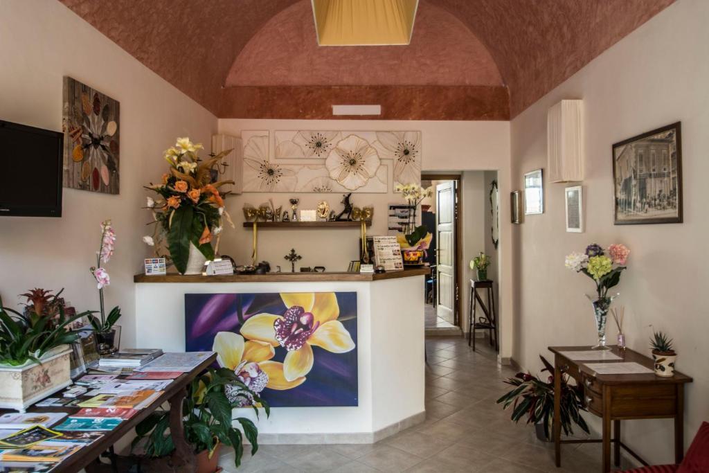 The lobby or reception area at Locanda dei Fiori