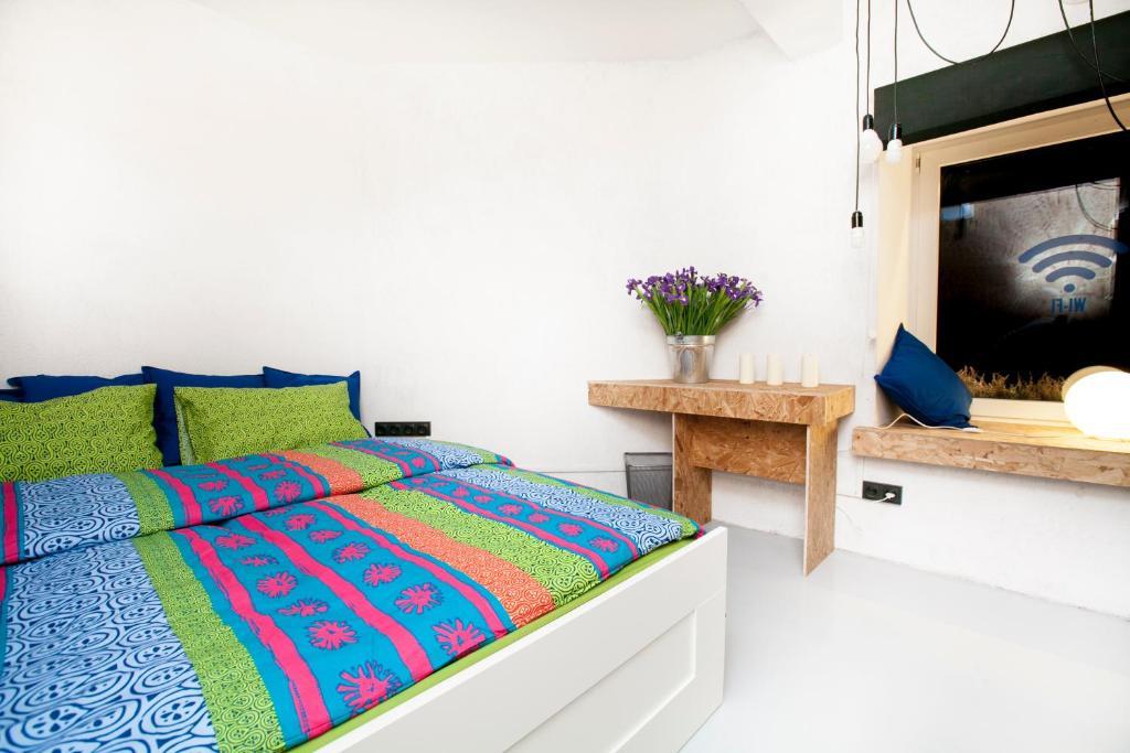 Кровать или кровати в номере Simple