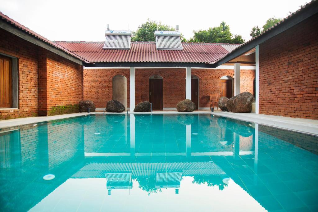 The swimming pool at or near Pinthaliya Resort & Spa