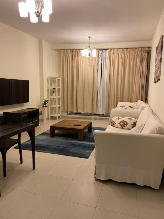 A seating area at Cozy Upgraded 1 bedroom Hall in Dubai Silicon Oasis