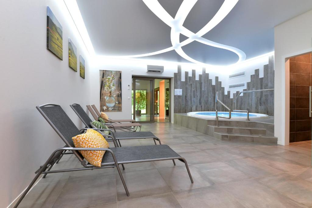 Het zwembad bij of vlak bij L'éclos des vignes - Appartements haut de gamme avec Spa