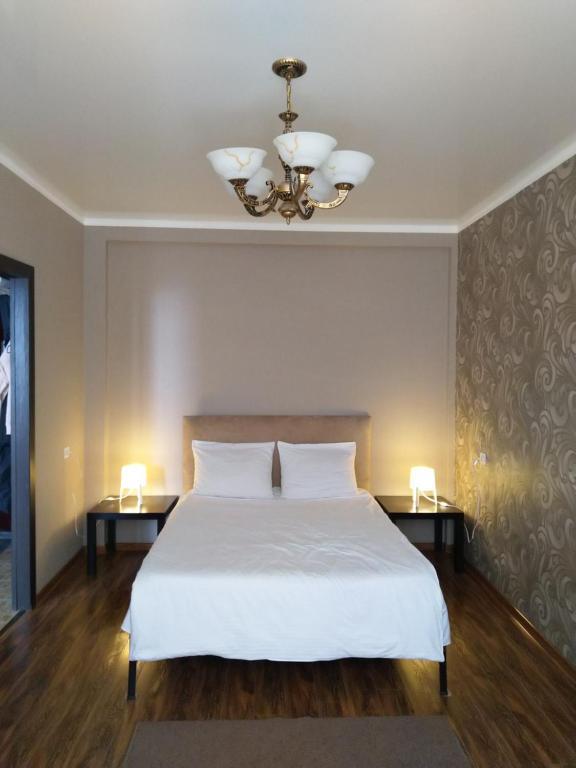 Кровать или кровати в номере Apartments at Tukhachevskogo