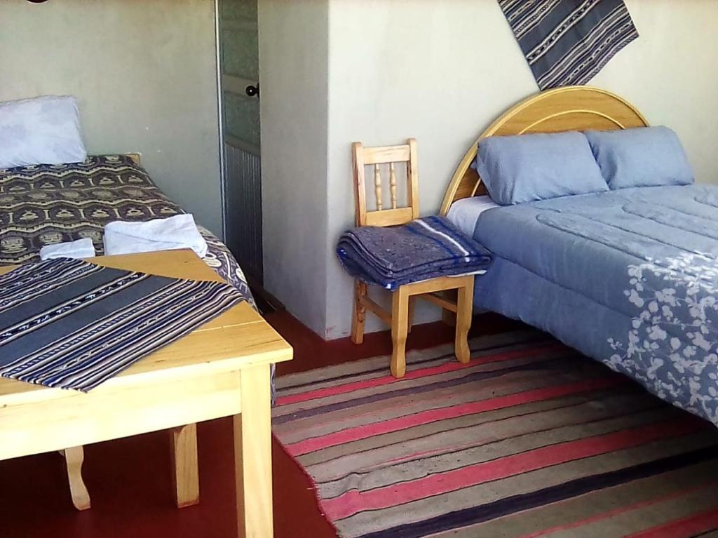 A bed or beds in a room at Alberto homestay taypi qamaña establo