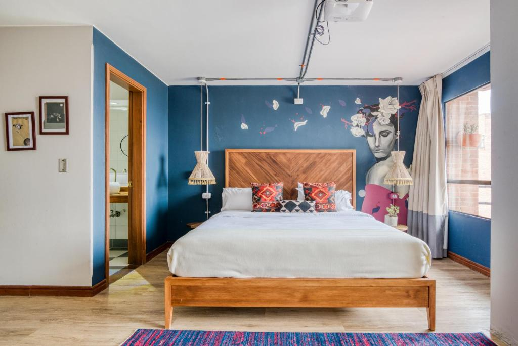 A bed or beds in a room at Selina Chapinero Bogota