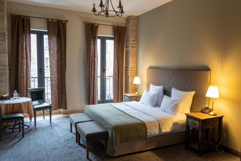 A bed or beds in a room at Apricot Hotel Yerevan