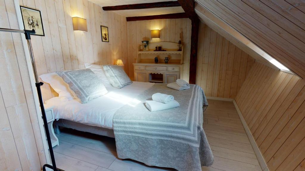 Un ou plusieurs lits dans un hébergement de l'établissement Le Clos bartholdi