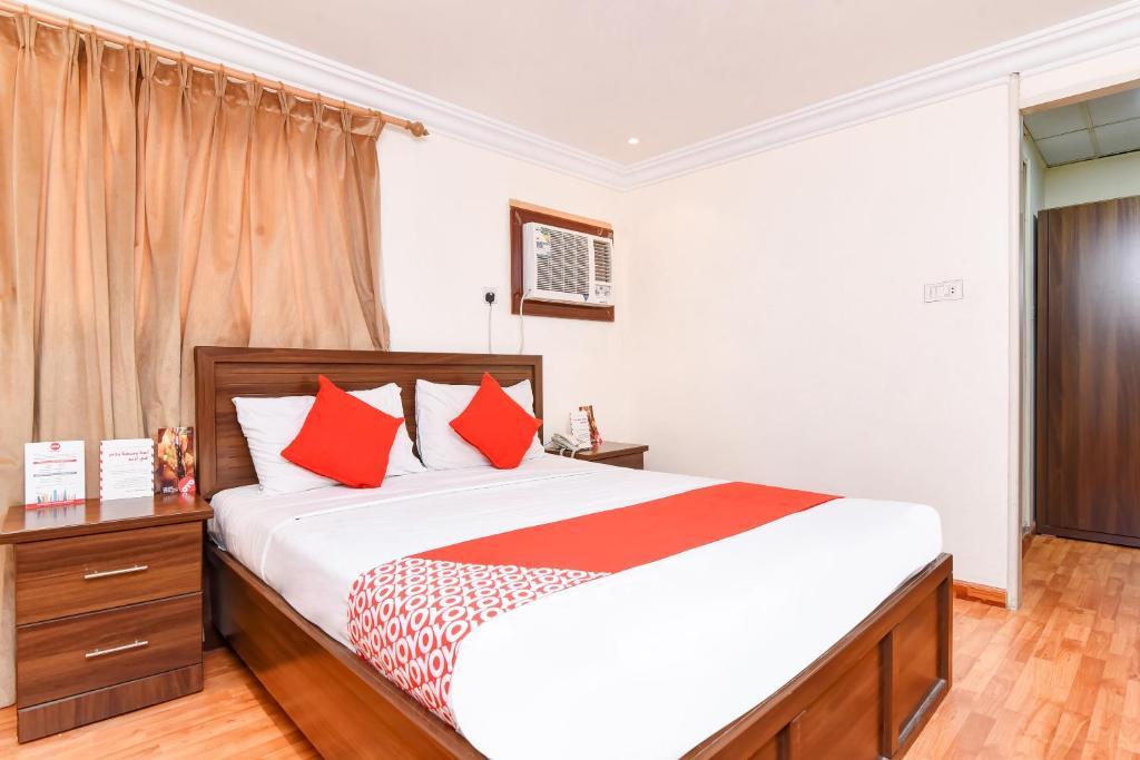 Cama ou camas em um quarto em OYO 416 Bonais Hotel