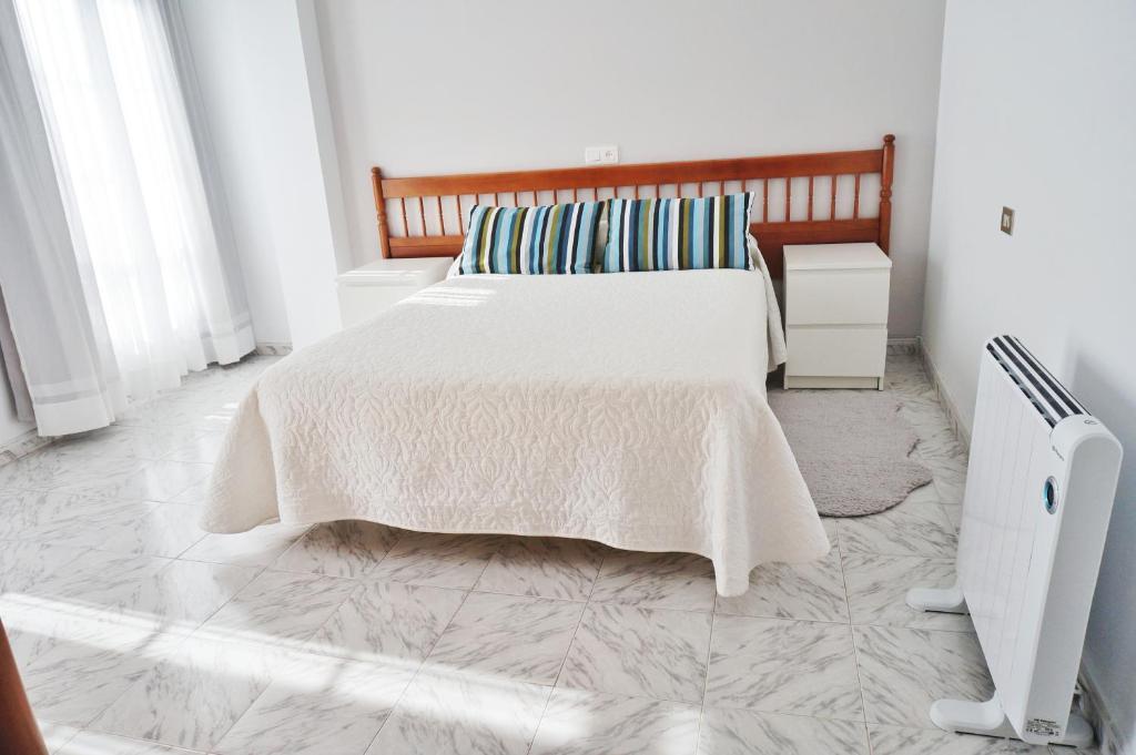 A bed or beds in a room at Vivienda de uso turístico Alma da Costa da Morte