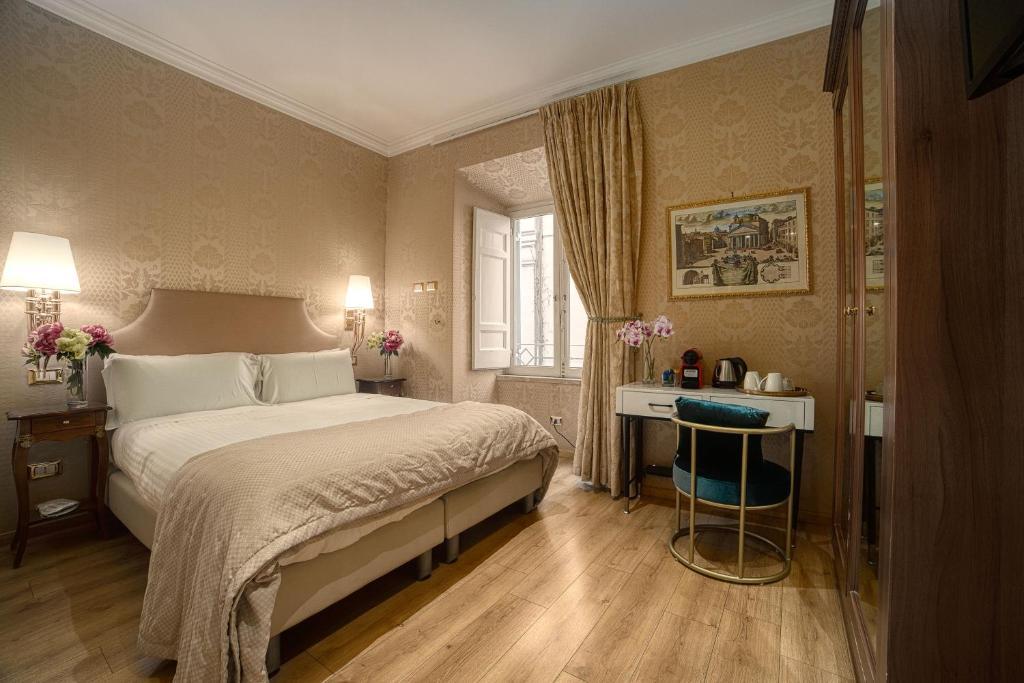Letto o letti in una camera di BQ House Trevi Luxury Rooms