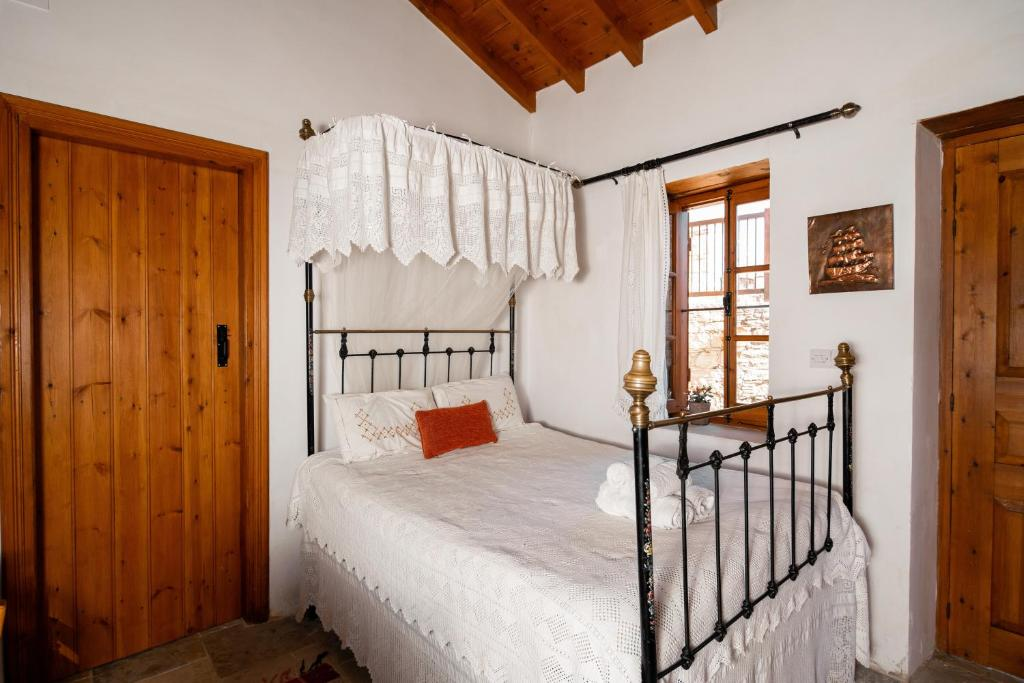 A bed or beds in a room at Constantias stone houses