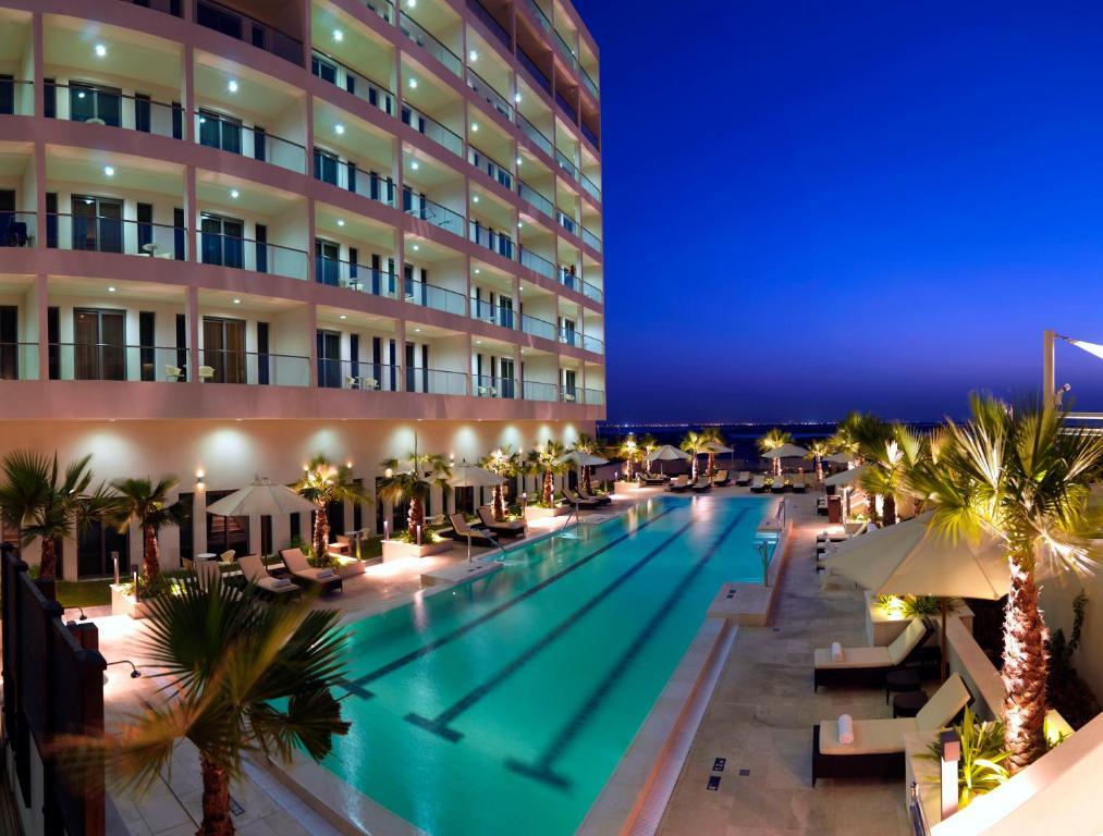 The swimming pool at or near Staybridge Suites Yas Island Abu Dhabi, an IHG Hotel