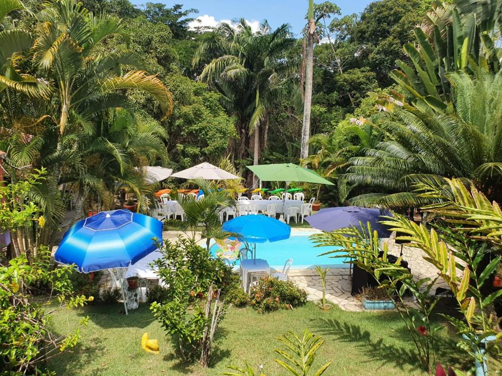 A view of the pool at CHÁCARA RECANTO DA MATA or nearby